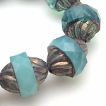 Spiral Central Cut- Deep Aqua Blue Opaline with Purple Bronze Finish 12x10mm