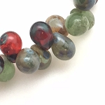 Drops - Mix of red, transparent and greens with a picasso finish.- 5x7mm