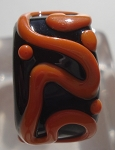 Raised Swirl Glass Lampwork Bead - Black and Orange